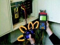 The PCE-360 power analyzer and the portable energy meter measuring an electric cupboard.