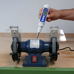 Here you will see a vibration meter testing a machine.