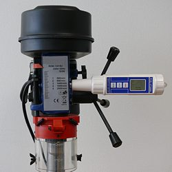 This image shows the vibration meter testing a fixing drilling machine