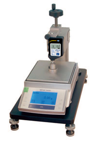 A calibration device to check the forces on durometer