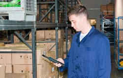 Humidity meter PCE-330 in use in a warehouse.