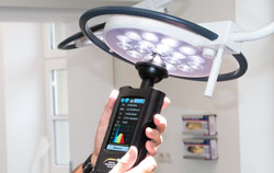 Checking operating theater light in the operating room by a light meter.