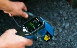 Temperature checking of asphalt at road construction.