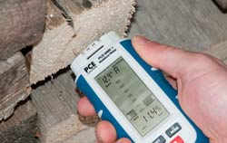 Wood Moisture Meter at a application for checking firewood.
