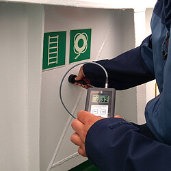 Thickness gauge during the application on a ship.